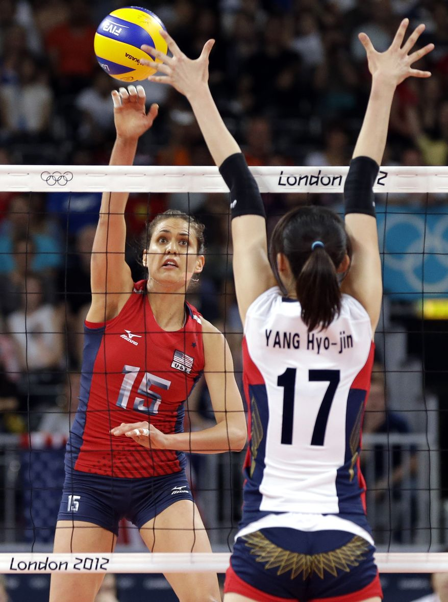 United States' Logan Tom (15) spikes the ball at South Korea's Yang Hyo-jin during a women's volleyball semifinal match Aug. 9, 2012, at the 2012 Summer Olympics in London. (Associated Press)