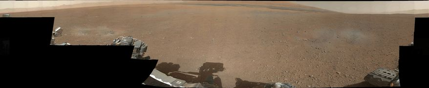 This image provided by NASA on Aug. 9, 2012, shows the first 360-degree color panorama taken on Mars by NASA's Curiosity rover. The panorama was stitched together using thumbnail images taken by the rover's mast camera. Curiosity landed in Gale Crater on Mars four days earlier to begin a two-year mission. (Associated Press/NASA)