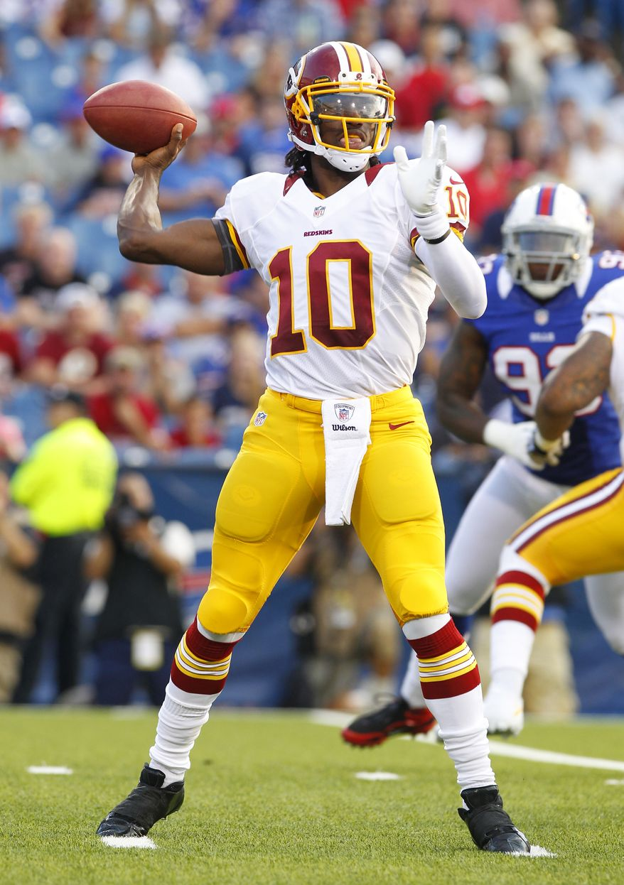 Washington Redskins quarterback Robert Griffin III throws during the first half of a preseason NFL football game against the Buffalo Bills in Orchard Park, N.Y., Thursday, Aug. 9, 2012. (AP Photo/Bill Wippert)