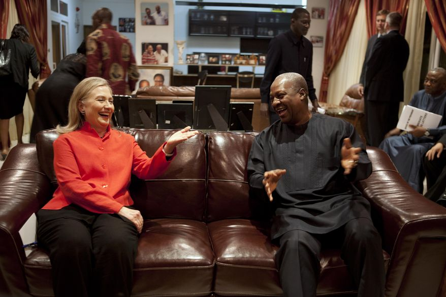 U.S. Secretary of State Hillary Rodham Clinton (left) meets Aug. 9, 2012, with Ghana's President John Dramani Mahama at his residence in Accra, Ghana. (Associated Press)