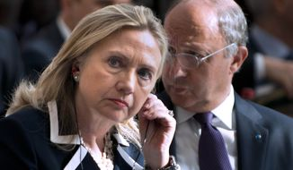 "** FILE ** In this July 6, 2012, file photo, U.S. Secretary of State Hillary Rodham Clinton and French Foreign Minister Laurent Fabius attend the ""Friends of Syria"" conference in Paris. The United States is readying new sanctions on Syrian President Bashar Assad's regime and its allies as Clinton heads to Turkey on Friday, Aug. 10, 2012, for weekend talks with top Turkish officials and Syrian opposition activists. (AP Photo/Brendan Smialowski, Pool, File)"