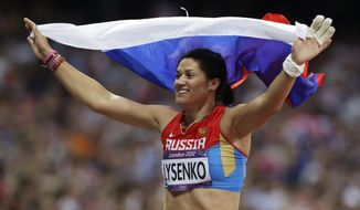 Russia's Tatyana Lysenko reacts after winning gold in the women's hammer throw final during the athletics in the Olympic Stadium at the 2012 Summer Olympics, London, Friday, Aug. 10, 2012. (AP Photo/Hassan Ammar)