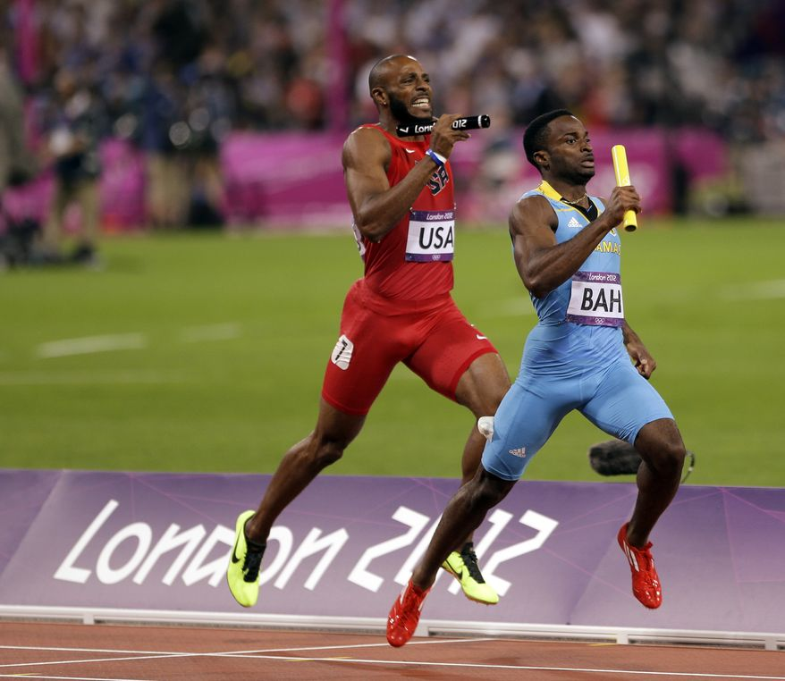Bahamas's Ramon Miller leads USA's Angelo Taylor during the final leg of the men's 4x400-meter during the athletics in the Olympic Stadium at the 2012 Summer Olympics, London, Friday, Aug. 10, 2012. (AP Photo/Matt Slocum)