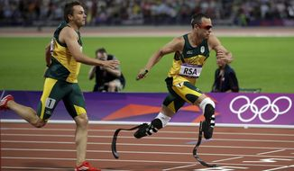 South Africa's Oscar Pistorius takes the baton from teammate L J van Zyl during the men's 4x400-meter during the athletics in the Olympic Stadium at the 2012 Summer Olympics, London, Friday, Aug. 10, 2012. (AP Photo/Matt Slocum)