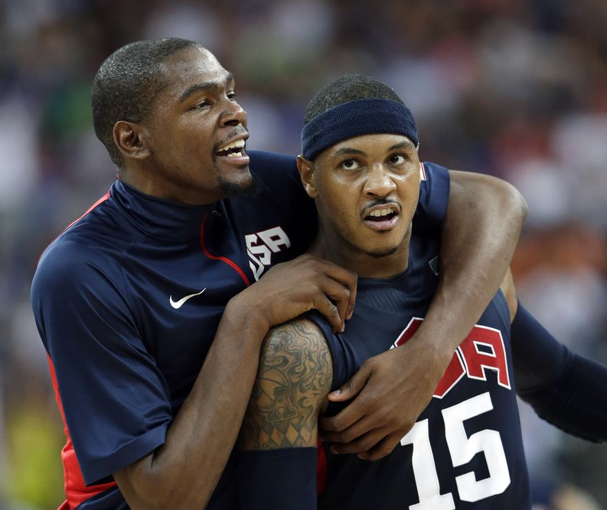 United States' Kevin Durant, left, celebrates with teammate Carmelo Anthony (15) after he scored during a semifinal men's basketball game against Argentina at the 2012 Summer Olympics, Friday, Aug. 10, 2012, in London. (AP Photo/Eric Gay)