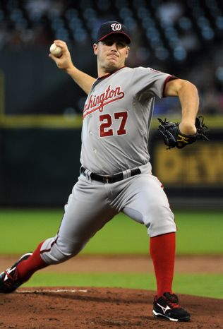 Washington Nationals' Jordan Zimmermann delivers a pitch against the Houston Astros in the first inning of a baseball game Thursday, Aug. 9, 2012, in Houston. (AP Photo/Pat Sullivan)