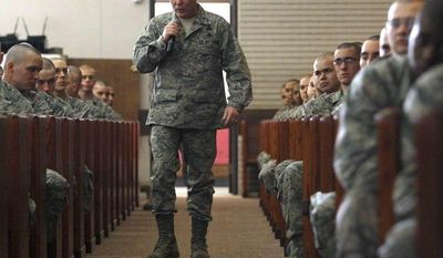 ** FILE ** In this March 2, 2012, photo, Air Force Col. Glenn Palmer, commander of the 737th Training Group at Lackland AFB, speaks to trainees in San Antonio. Officials tell the Associated Press that the Air Force has relieved Palmer, a top commander at Lackland Air Force base, from his position in the wake of wake of a widening sex scandal. (AP Photo/The San Antonio Express-News, William Luther)