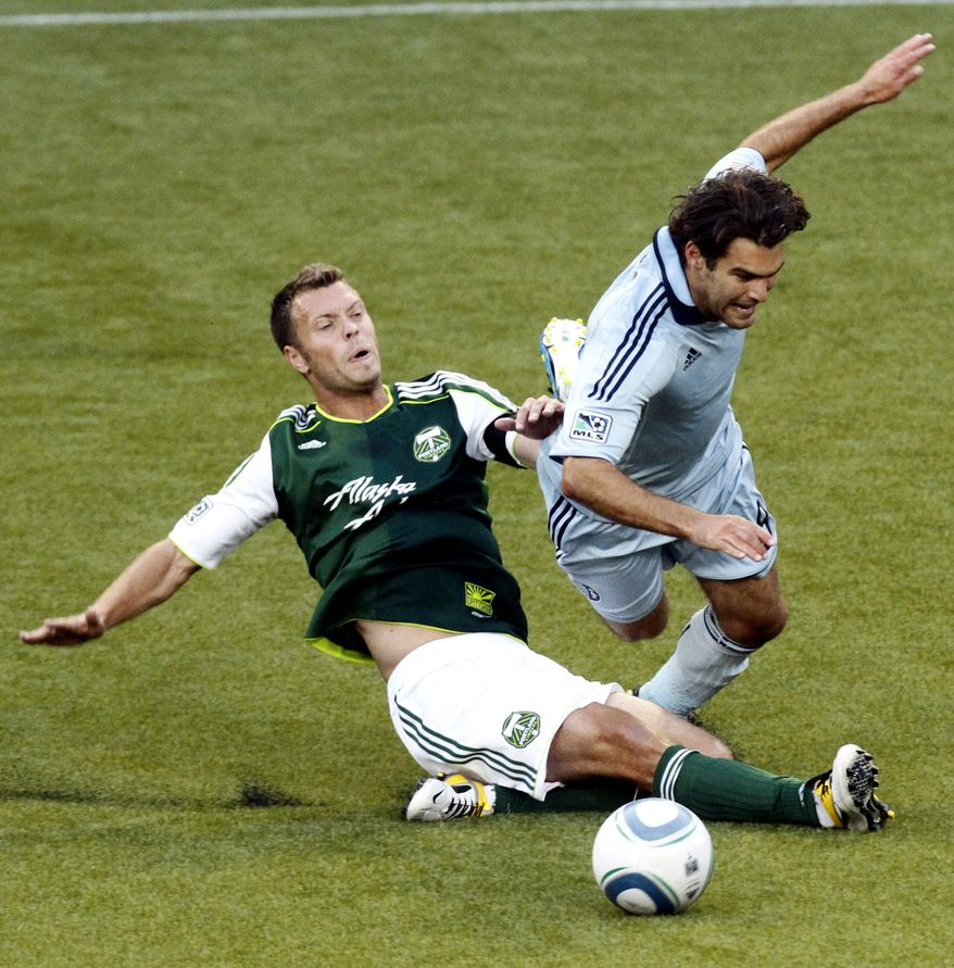 Sporting Kansas City's Graham Zusi (right) had a goal and an assist in his team's 2-1 win over D.C. United on Saturday. (AP Photo/Don Ryan, File)