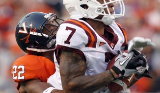 Virginia Tech wide receiver Marcus Davis (7) hauls in a pass as Virginia cornerback Drequan Hoskey (22) makes the tackle during the first half of an NCAA college football game at Scott Stadium in Charlottesville, Va., Saturday, Nov. 26, 2011. (AP Photo/Steve Helber)