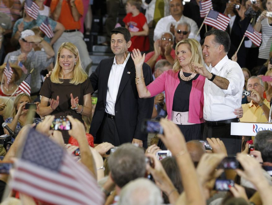 Republican Presidential candidate, Mitt Romney, right, his wife, Ann, second from right, wave to the crowd along with his running mate, Rep. Paul Ryan, R-Wis., second form left, and his wife, Janna, left, during a rally at Randolph-Macon College in Ashland, Va., Saturday, Aug. 11, 2012. (AP Photo/Steve Helber)