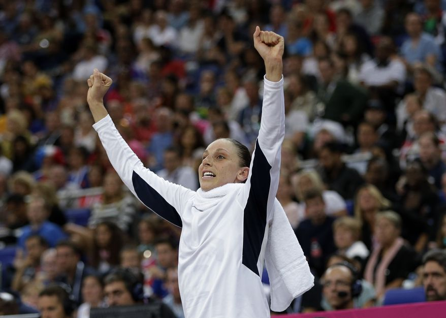United States Diana Taurasi raises her arms during a women's gold medal basketball game against France at the 2012 Summer Olympics, Saturday, Aug. 11, 2012, in London. (AP Photo/Eric Gay)