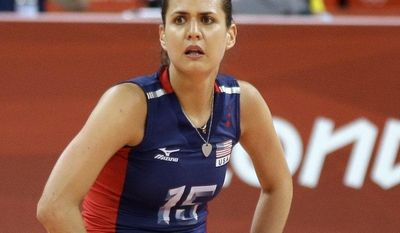 USA's Logan Tom (15) reacts after Brazil scores a point during a women's volleyball gold medal match at the 2012 Summer Olympics Saturday, Aug. 11, 2012, in London. (AP Photo/Chris O'Meara)