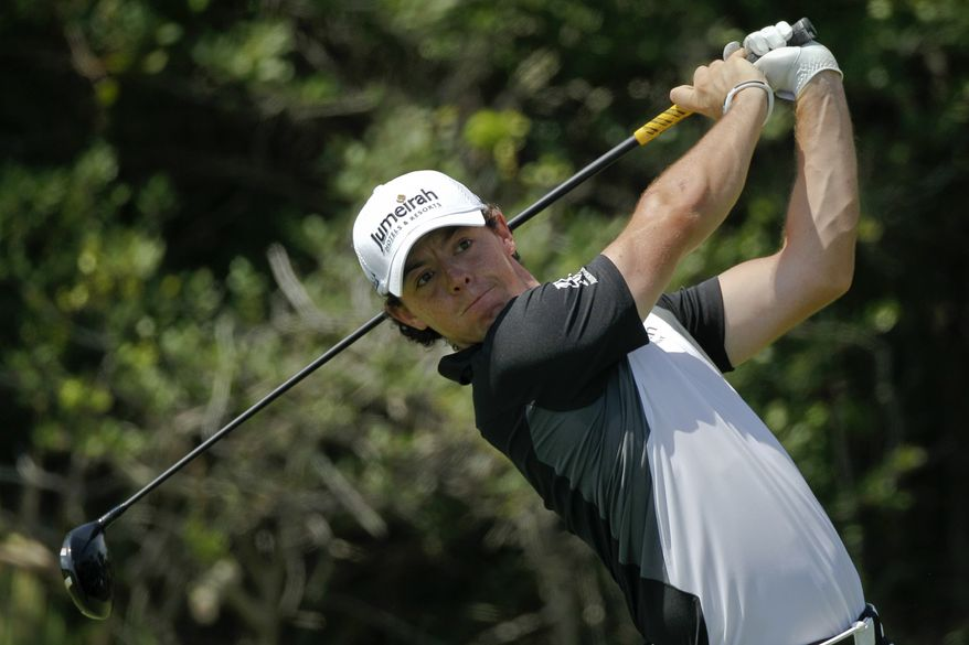Rory McIlroy of Northern Ireland watches his drive from the send tee during the third round of the PGA Championship golf tournament on the Ocean Course of the Kiawah Island Golf Resort in Kiawah Island, S.C., Saturday, Aug. 11, 2012. (AP Photo/Evan Vucci)