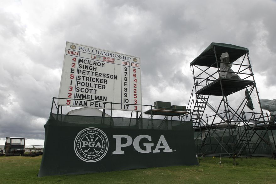 Storm clouds are seem behind the score board after play was halted for weather during the third round of the PGA Championship golf tournament on the Ocean Course of the Kiawah Island Golf Resort in Kiawah Island, S.C., Saturday, Aug. 11, 2012. (AP Photo/John Raoux)