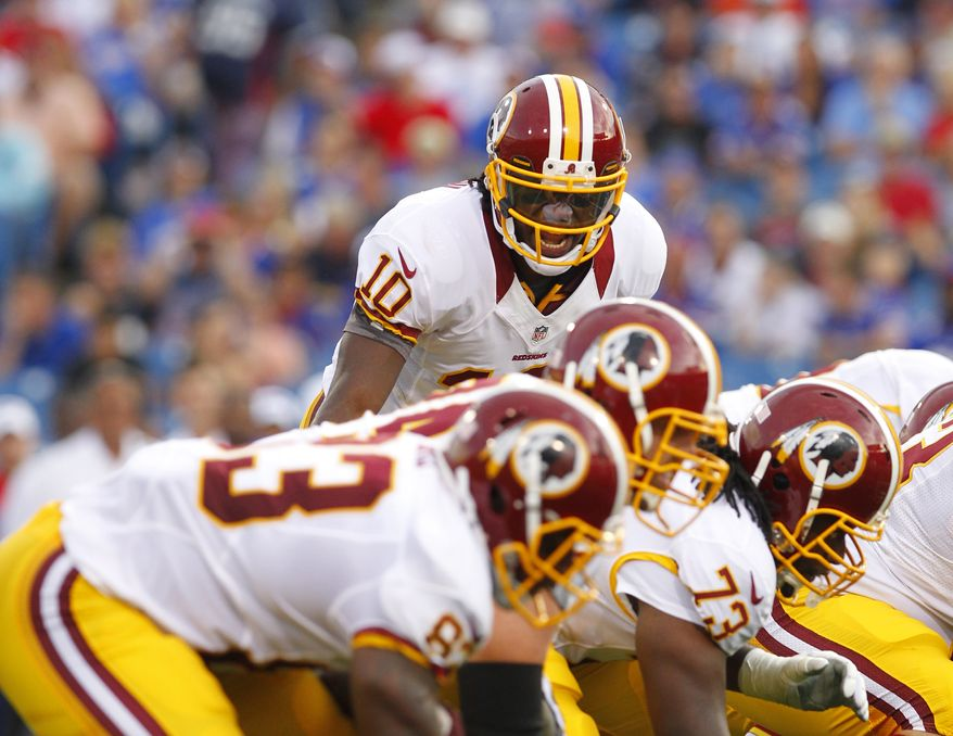 The Washington Redskins' line has been struck with injuries as four of the five projected starters missed Saturday's practice. (AP Photo/Bill Wippert)