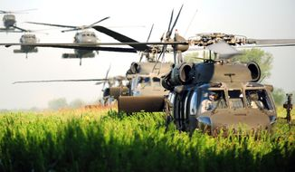 U.S. Army UH-60 Black Hawk helicopters arrive to pick up soldiers during an exercise at Fort Campbell, Ky., for Week of the Eagles. (Image: U.S. Army) ** FILE **
