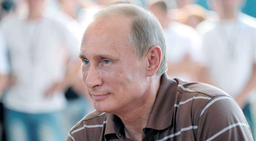 President Vladimir Putin talks to pro-Kremlin youth. (Associated Press)