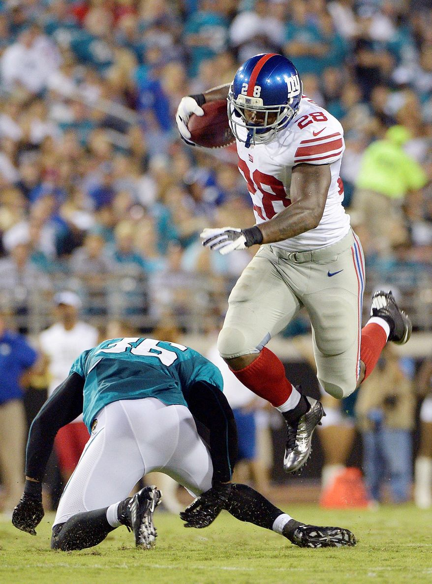 New York Giants running back D.J. Ware, working to claim a spot in the backfield alongside Ahmad Bradshaw, rushed for 30 yards and a touchdown Friday night. (Associated Press)