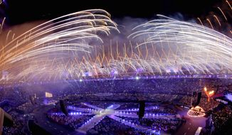 Fireworks soar over the Olympic Stadium as the flame is lowered Sunday during the closing ceremony for the 2012 Summer Games in London. The torch was passed to Rio de Janeiro for the 2016 Games. (Associated Press)