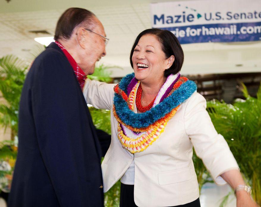 Democrat Rep. Mazie Hirono, right, hugs U.S. Senator Daniel Inouye after Hirono won the Democratic primary nomination for a Hawaii seat in the U.S. Senate, Saturday, Aug. 11, 2012 in Honolulu. (AP Photo/Marco Garcia)