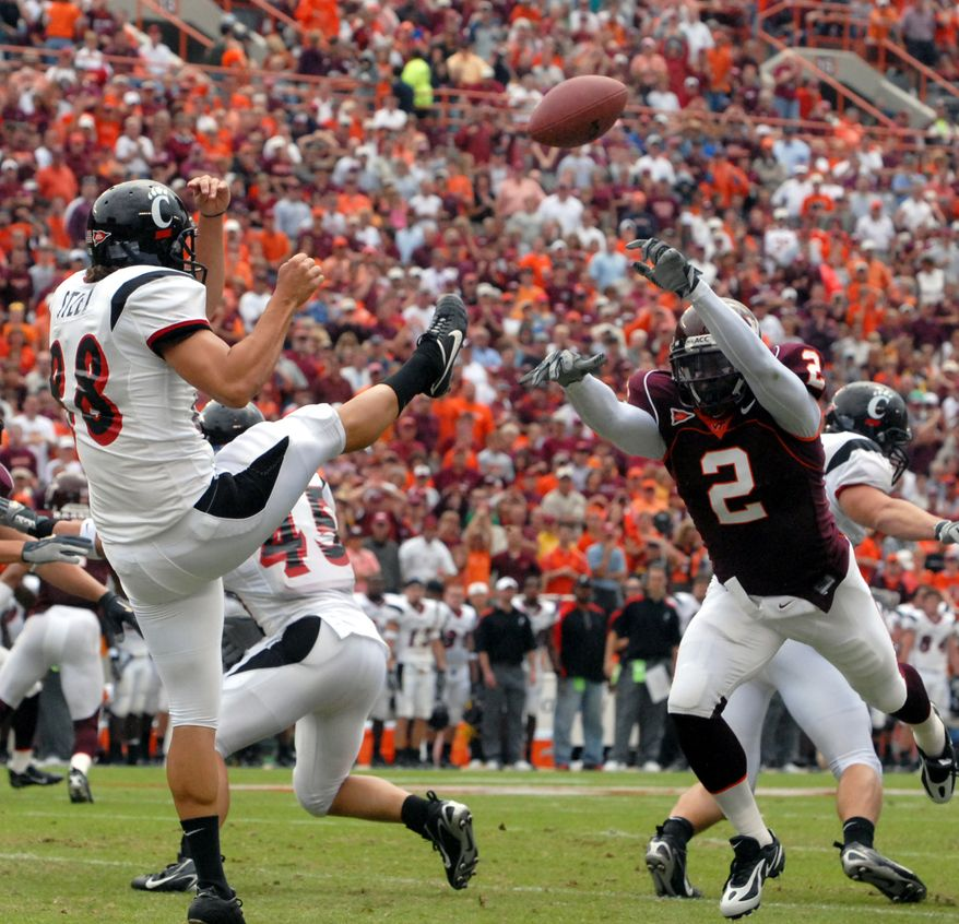 Virginia Tech safety Josh Morgan blocks a punt against Cincinnati's Brian Steel during first quarter action at Lane Stadium in Blacksburg, Va, Saturday Sept. 23, 2006.  (AP Photo/Don Petersen)