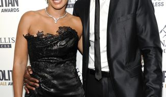 ** FILE ** NFL football player Chad Johnson poses with his then-fiancee, Evelyn Lozada, at an event in New York  on Wednesday, March 7, 2012. (AP Photo/Evan Agostini)