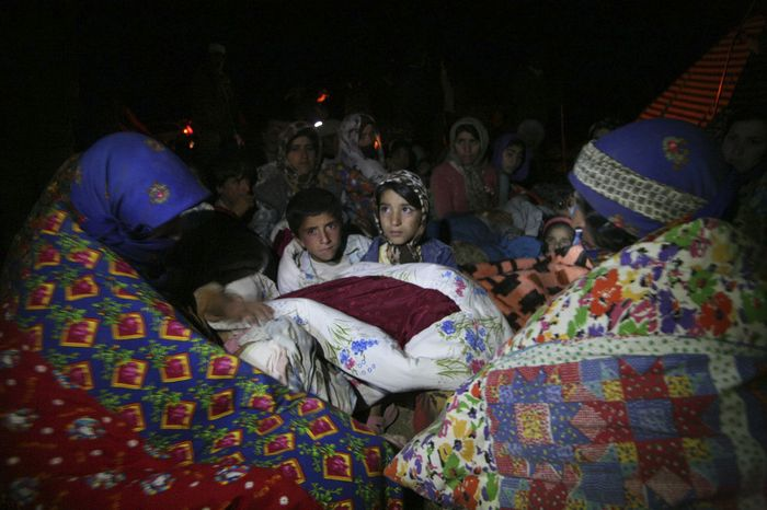 Residents spend the night outside their homes after an earthquake in Varzaqan, Iran, on Saturday, Aug. 11, 2012. (AP Photo/Mehr News Agency, Ali Hamed Haghdoust)