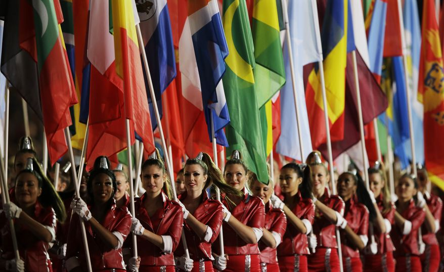 Flag bearers parade during the Closing Ceremony at the 2012 Summer Olympics, Sunday, Aug. 12, 2012, in London.  (AP Photo/Matt Slocum)