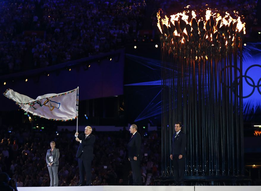 London mayor Boris Johnson, second from left, waves the Olympic flag as President of the International Olympic Committee Jacques Rogge, center, and Eduardo Paes, mayor of Rio de Janeiro look on during the Closing Ceremony at the 2012 Summer Olympics, Sunday, Aug. 12, 2012, in London. (AP Photo/Matt Dunham)