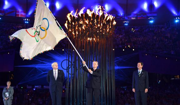 The Olympics flag is handed from London Mayor, Boris Johnson, second from left, to the International Olympic Committee President Jacques Rogge, center, next to the Mayor of Rio de Janeiro, Eduardo Paes, right, during the Closing Ceremony of the 2012 Summer Olympics on Sunday, Aug. 12, 2012, in London. (AP Photo/Jeff J Mitchell, Pool)