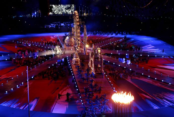 Performers dance on a stage set with London landmarks during the Closing Ceremony at the 2012 Summer Olympics, Sunday, Aug. 12, 2012, in London. (AP Photo/Ivan Sekretarev)