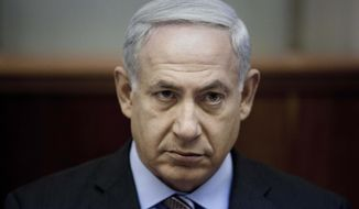 Israeli Prime Minister Benjamin Netanyahu chairs the weekly Cabinet meeting in Jerusalem on Sunday, Aug. 12, 2012. (AP Photo/Abir Sultan, Pool)