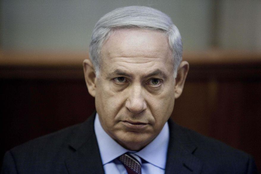 Israeli Prime Minister Benjamin Netanyahu chairs the weekly Cabinet meeting in Jerusalem on Sunday, Aug. 12, 2012. (AP Photo/Abir Sultan, Pool)