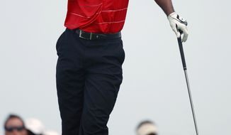 Tiger Woods reacts to his tee shot on the ninth hole during the final round of the PGA Championship golf tournament on the Ocean Course of the Kiawah Island Golf Resort in Kiawah Island, S.C., Sunday, Aug. 12, 2012. (AP Photo/John Raoux)