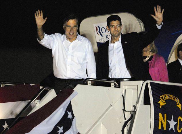 Presumptive Republican presidential nominee Mitt Romney (left) and his vice presidential running mate, Rep. Paul Ryan, arrive at Wilson Air Field in Charlotte, N.C., on Saturday, Aug. 11, 2012. (AP Photo/The Charlotte Observer, Adam Jennings)