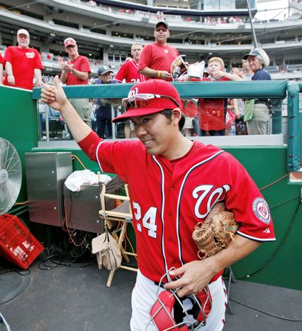 Nationals catcher Kurt Suzuki made some new friends in Washington by signing autographs after a game against Miami on Aug. 5. Suzuki had been acquired from Oakland two days earlier. (Associated Press)