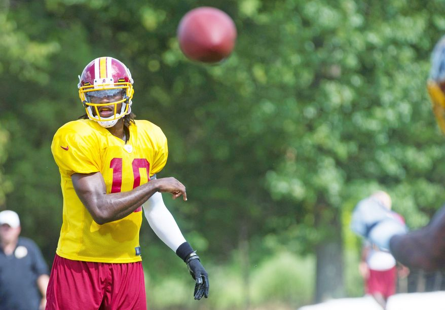 Redskins QB Robert Griffin III ran 14 plays with the first-string offense in the preseason opener at Buffalo on Thursday night. Washington won 7-6, highlighted by a Pierre Garcon touchdown. (Rod Lamkey Jr./The Washington Times)