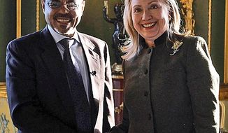 **FILE** U.S. Secretary of State Hillary Rodham Clinton meets Feb. 23, 2012, with Ethiopia's Prime Minister Meles Zenawi at the London Conference on Somalia. (Associated Press)