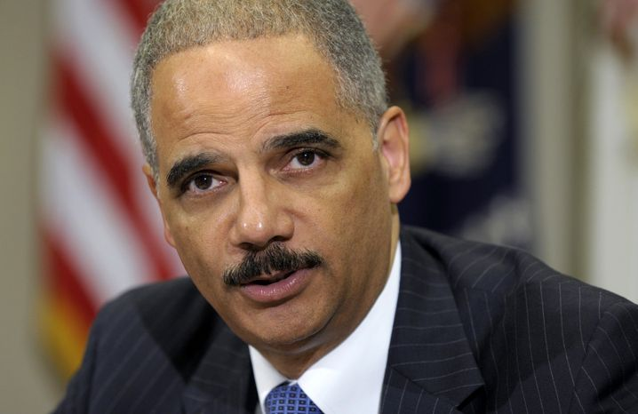 **FILE** Attorney General Eric H. Holder Jr. speaks July 26, 2012, in the Cabinet Room of the White House in Washington. (Associated Press)