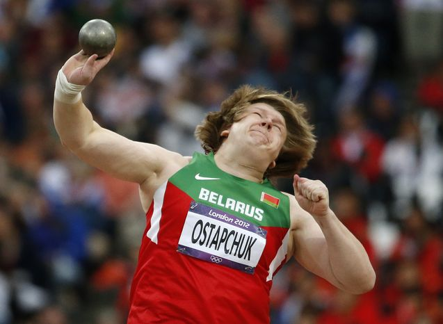 Nadzeya Ostapchuk of Belarus takes a throw in the women's shot put final at the Olympic Stadium at the 2012 Summer Olympics in London on Monday, Aug. 6, 2012. Ostapchuk became the first athlete to be stripped of a medal at the games after her gold was withdrawn for doping. (AP Photo/Matt Dunham)