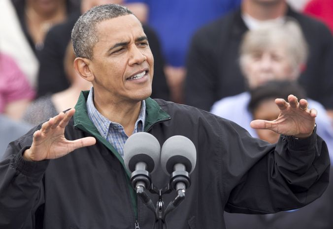 ** FILE ** President Obama speaks Aug. 13, 2012, during a campaign stop in Council Bluffs, Iowa. (Associated Press)