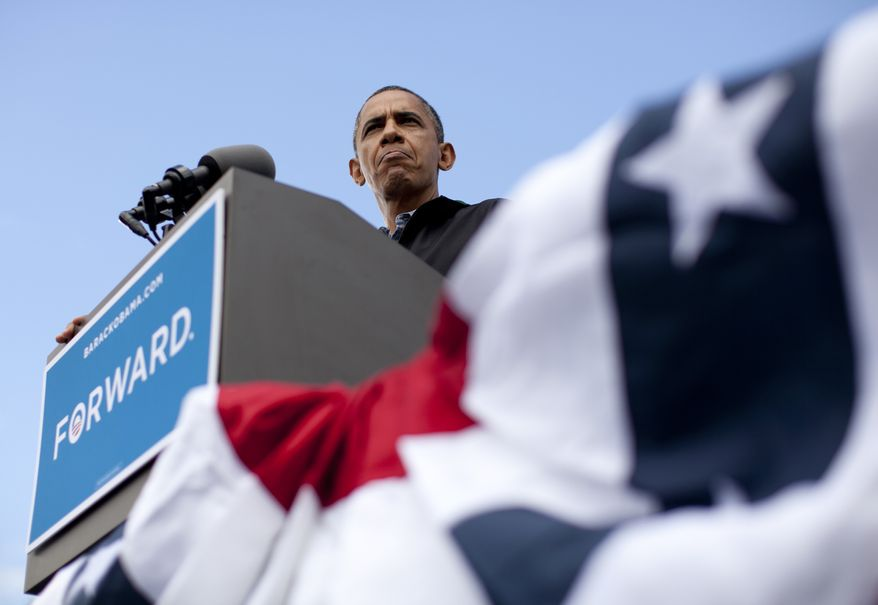 President Obama speaks Aug. 13, 2012, during a campaign event at Bayliss Park in Council Bluffs, Iowa, during a three-day campaign bus tour through the state. (Associated Press)