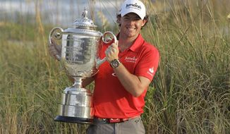 Rory McIlroy hoists the Wanamaker Trophy, which he earned with his eight-shot victory in the PGA Championship at Kiawah Island on Sunday. (Associated Press)