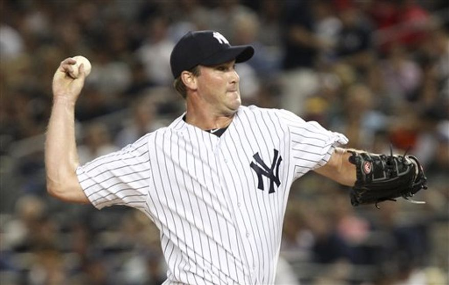 New York Yankees' Derek Lowe pitches during the sixth inning of the baseball game against the Texas Rangers Monday, Aug. 13, 2012 at Yankee Stadium in New York. (AP Photo/Seth Wenig)