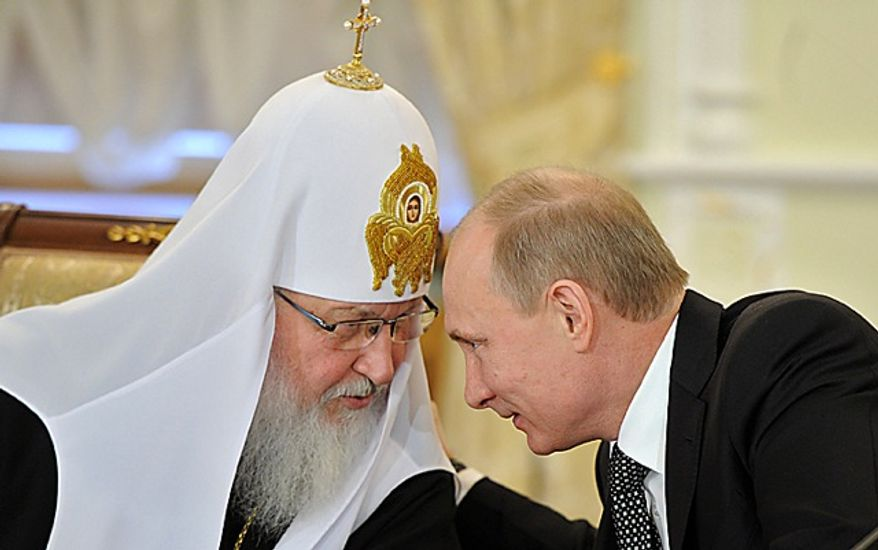 **FILE** Russian Prime Minister Vladimir Putin (right) speaks Feb. 8, 2012, with Russian Orthodox Patriarch Kirill during his meeting with Russia's religious leaders in the St. Daniel Monastery in Moscow. (Associated Press/RIA-Novosti, Yana Lapikova, Government Press Service)