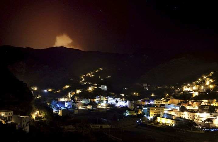 A wildfire advances Aug. 12, 2012, on the residential area in the evacuated Village of Valle Hermoso in La Gomera, Spain. Wildfires spurred by high temperatures raged across Spain's Canary Islands of La Gomera and Alicante. (Associated Press)