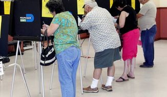 Voters fill out their ballots at Precinct 326 in Hialeah, Fla., during the state's primary election on Tuesday, Aug. 14, 2012. (Associated Press)