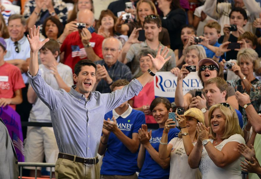 Republican vice presidential candidate Paul Ryan of Wisconsin waves Aug. 14, 2012, to supporters as he enters during a campaign rally in Lakewood, Colo. (Associated Press)