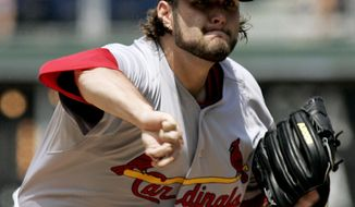 St. Louis Cardinals starting pitcher Lance Lynn throws in the second inning of a baseball game with the Philadelphia Phillies, Sunday, Aug. 12, 2012, in Philadelphia. The Phillies won 8-7 in the 11th inning. (AP Photo/Tom Mihalek)