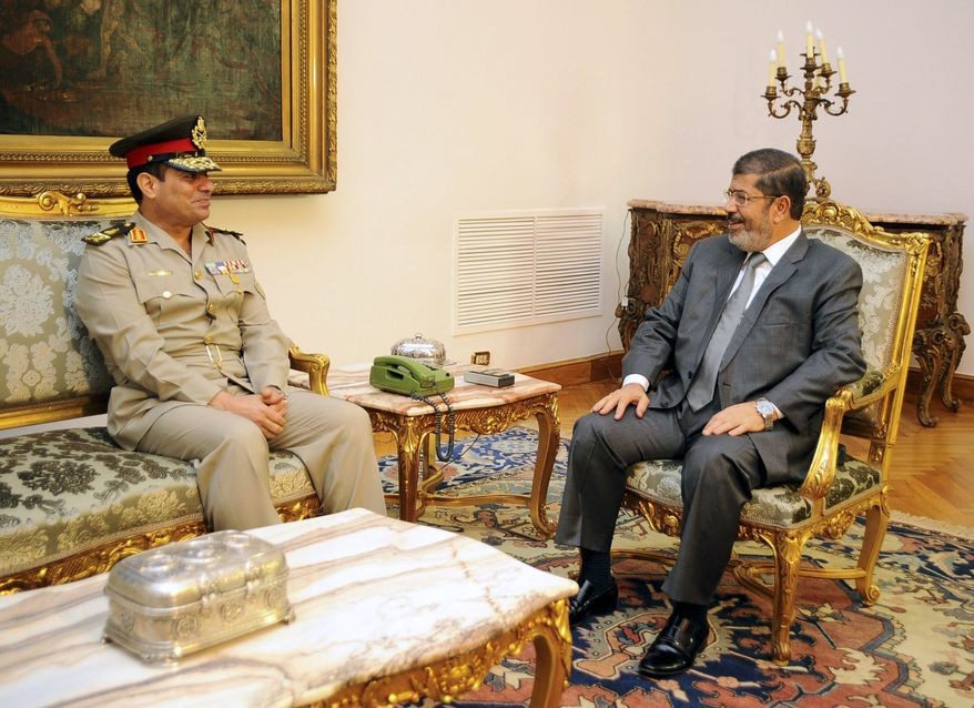 Newly-appointed Egyptian Minister of Defense, Lt. Gen. Abdel-Fattah el-Sissi, left, meets with Egyptian President Mohammed Morsi in Cairo, Egypt, Monday, Aug. 13, 2012. (AP Photo/Egyptian Presidency)